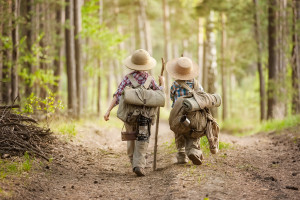 Tips for Hiking with Kids - Boys on a forest road with backpacks